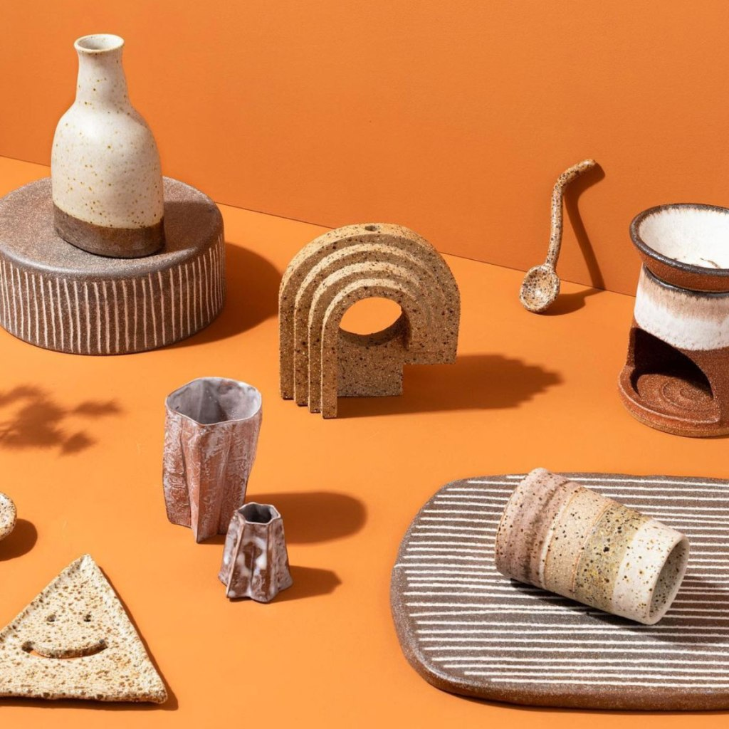 Ceramics on an orange background shot by Carli Wilson for Boom Gallery