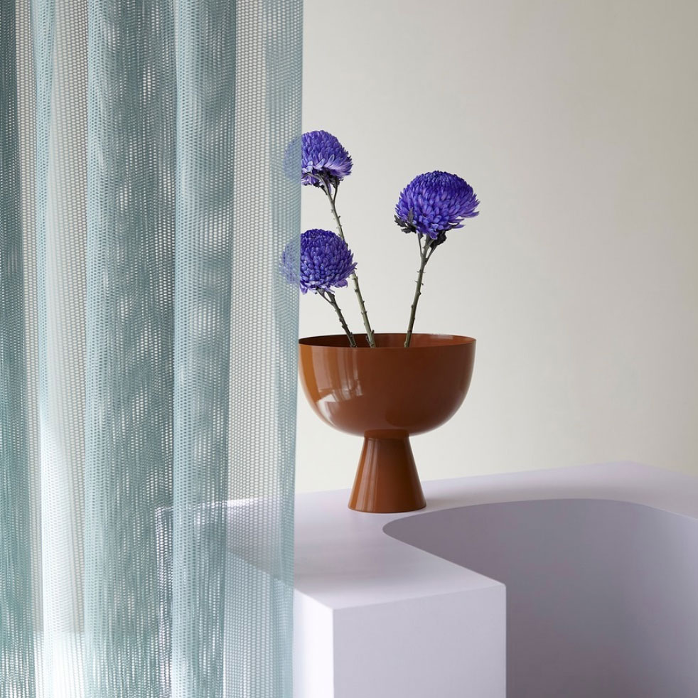 Lightly Design Vase on white plinth with flowers