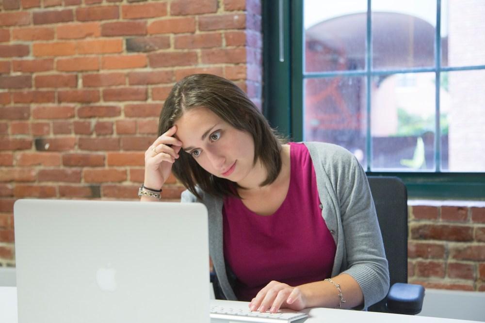 Woman writing marketing plan