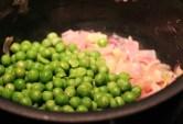 Add peas to the sauteed onions