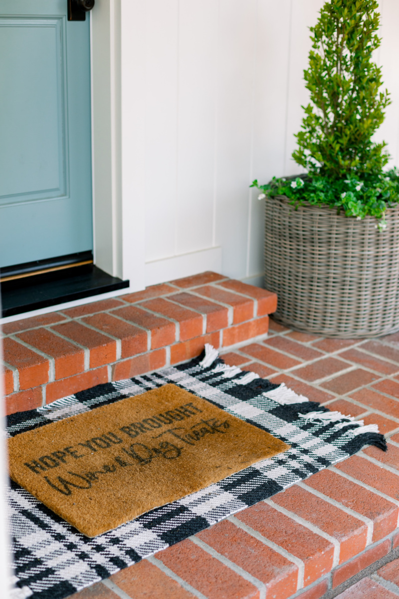 Black and white rug and layered doormat