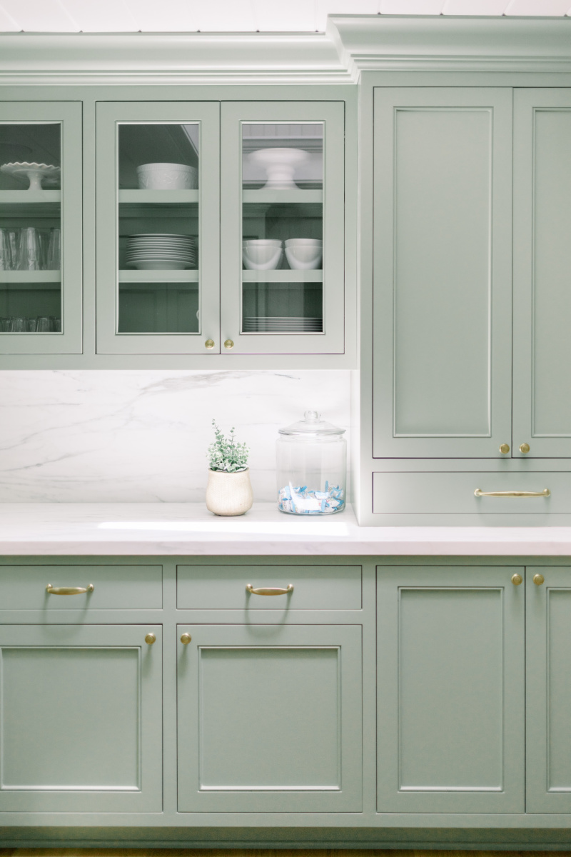 Sage Kitchen Cabinets with Glass Fronts