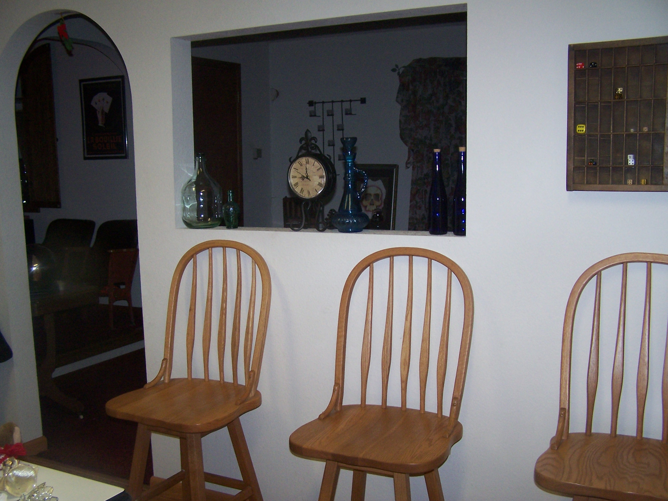The little window to the dining room. Enless possibilities. The clock happens to have faces on both sides!