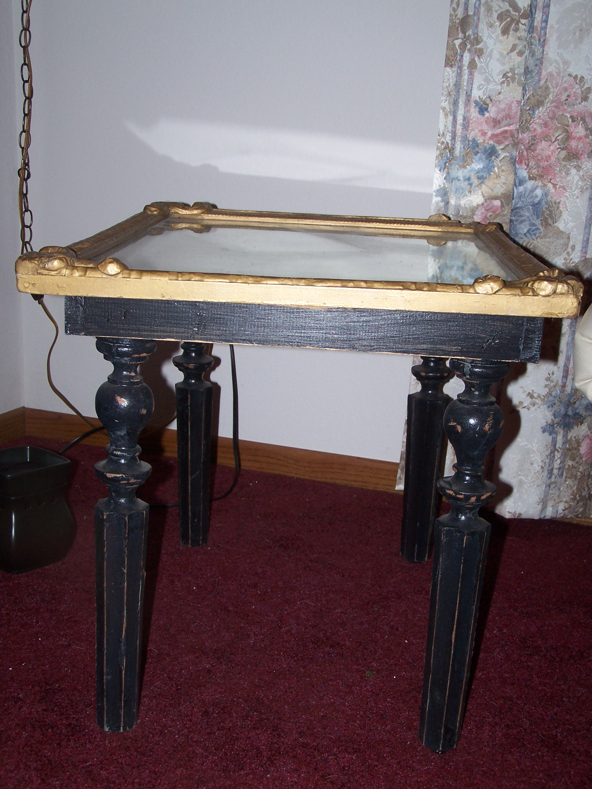 This is an old table with an antique frame used for the top.  We use it as our living room coffee table.  It has its dings and scratches, but I think thats what makes it so unique.