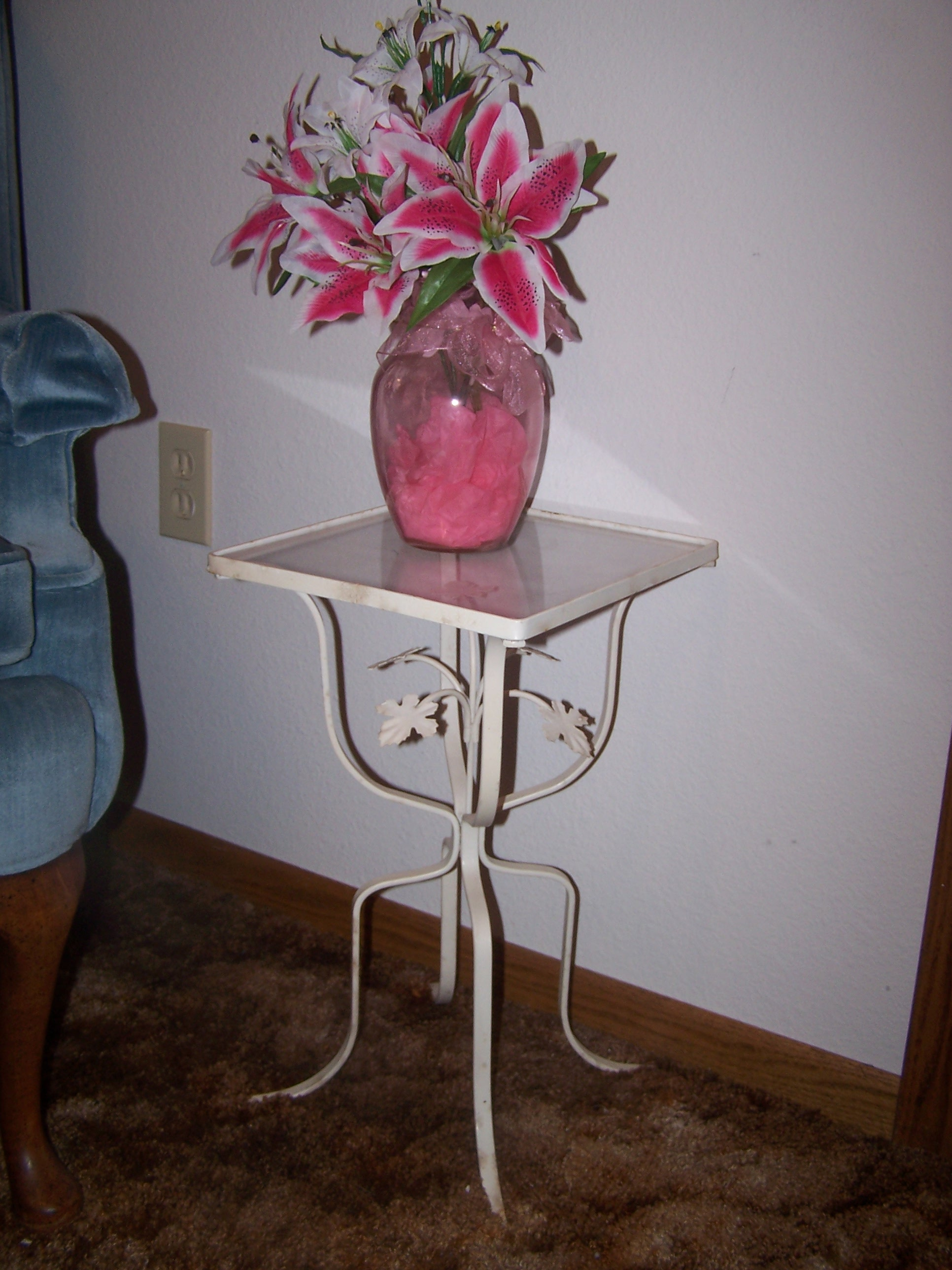 One of two old plant stands used as bedside tables in our guest room.