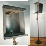 A 1930's- 1940's theater light. This would repurpose as a great lamp.