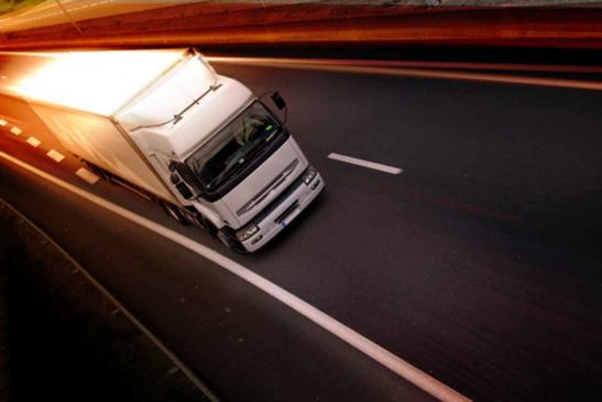 a-white-truck-on-highway-delivery-concept-xs-768