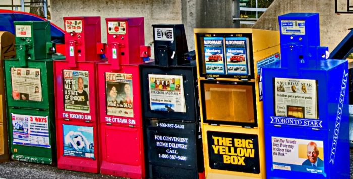 Photo of newspaper boxes outside