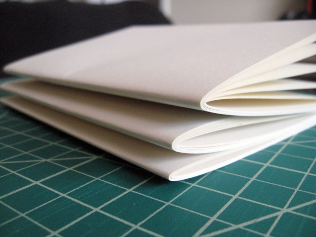folded sketchbook pages