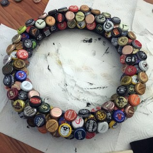 wreath covered in bottle caps