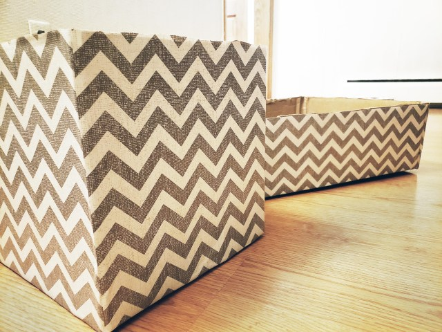 cardboard box covered in gray herringbone contact paper