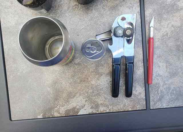 removing beer can lid with can opener