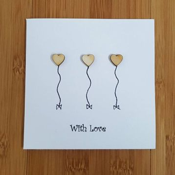 three wooden hearts card