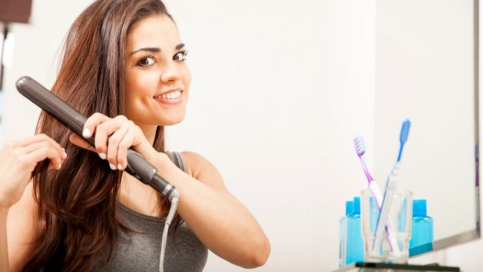 beautiful young hispanic woman using flat iron | Hairstyle Guide: Curling Hair With Flat Iron In 3 Simple Steps