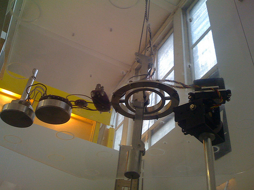 Robotic arm rotates plants in the sun's direction
