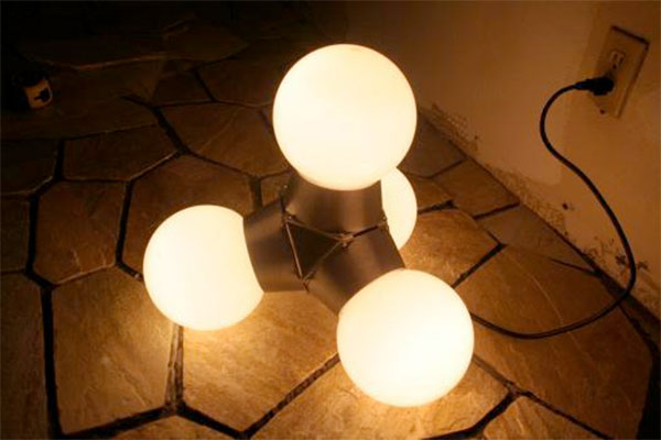 Tetrahedral lamp turns on by turning over