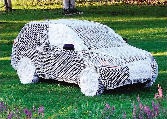 Artist has hard time getting back in to US for drawing of a crocheted SUV