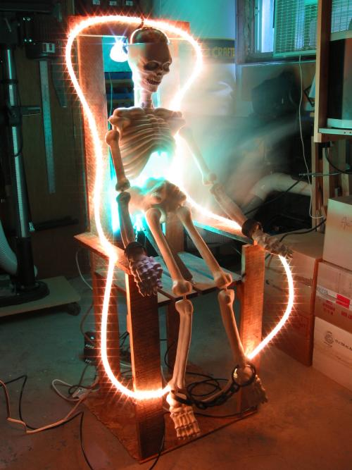 A skeleton is electrocuted on Mark Csele's porch