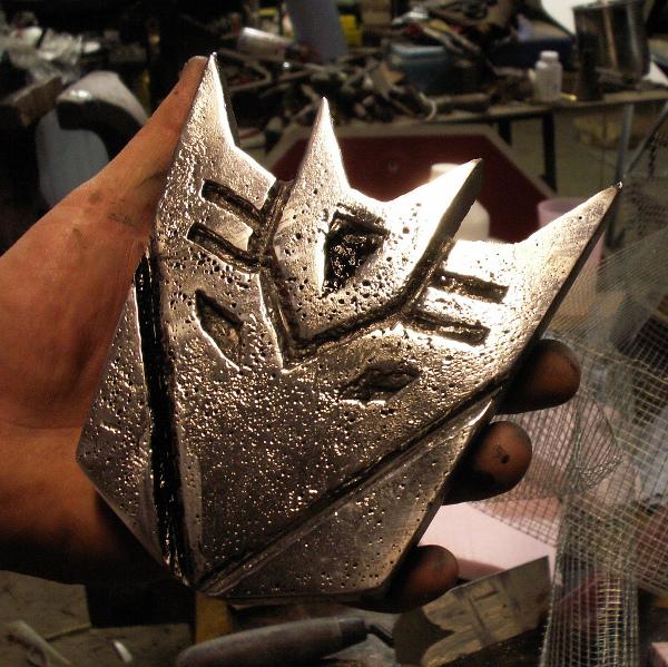 Sandcast aluminum Decepticon symbol