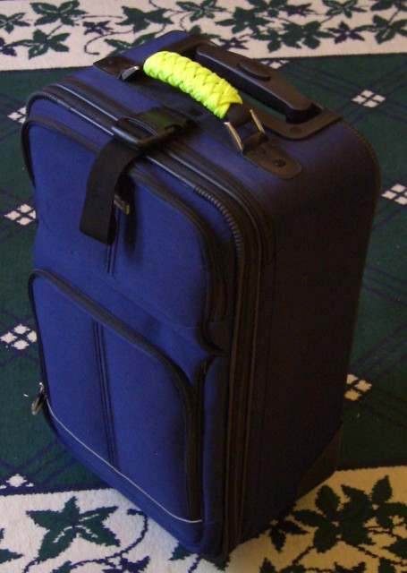 High-visibility paracord luggage handle wrap