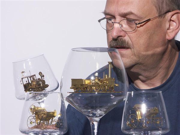 Tiny solar-powered brass engine in a wineglass