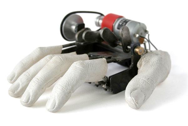 Disembodied mechanical hand looks unamused …