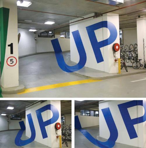 Anamorphic parking garage signage