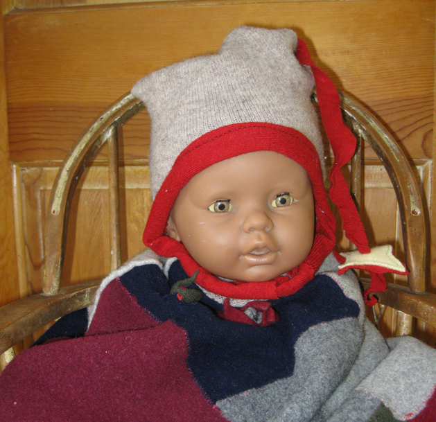 """Wool """"Won't Come Off"""" Baby Helmet from a Sweater Sleeve"""