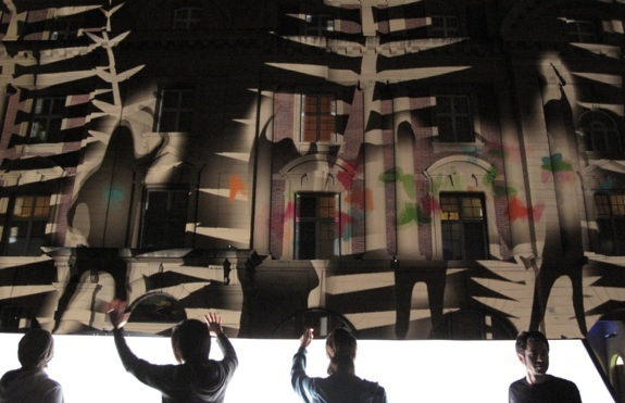 Night Lights projects actions five stories tall