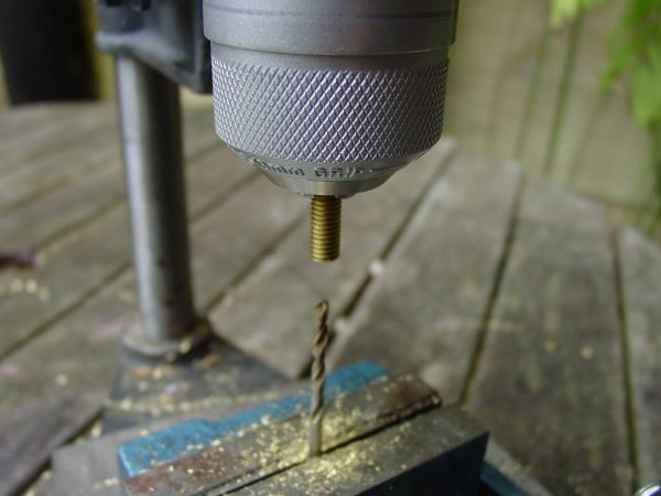 Use your drill press in reverse to make perfectly centered holes