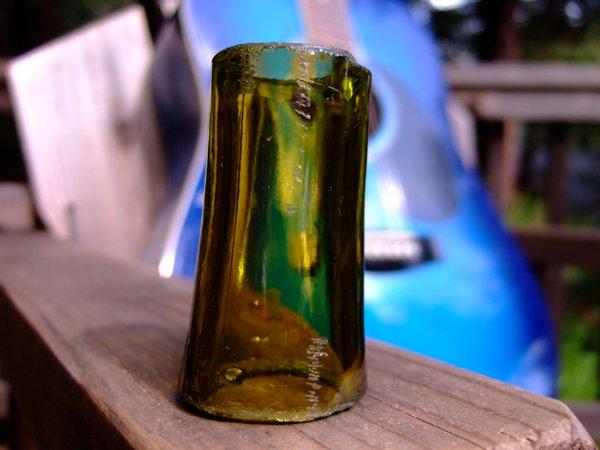 Guitar slide from glass bottle
