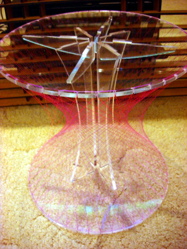 Hyperboloid stool from acrylic and monofilament