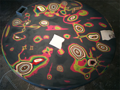 Color-layered table decorated by sanding