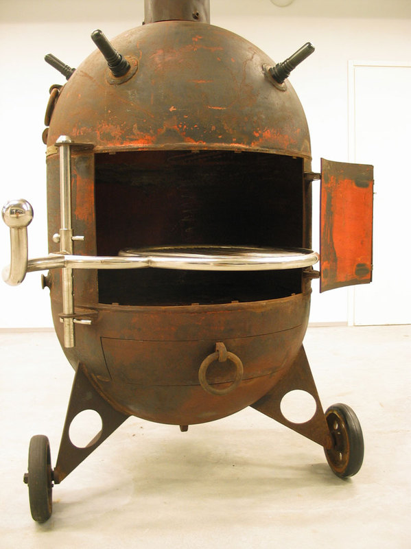 Charcoal grill made from recycled naval mine casings
