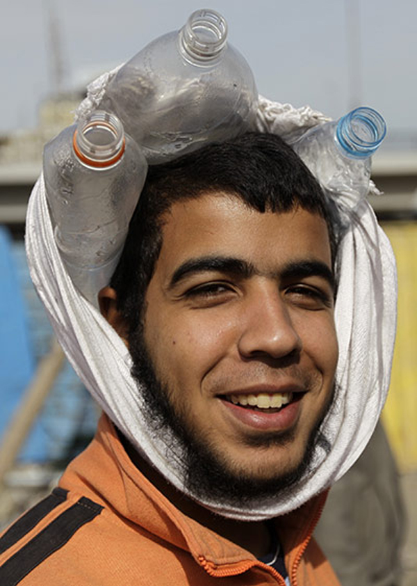 Improvised helmets in the streets of Cairo