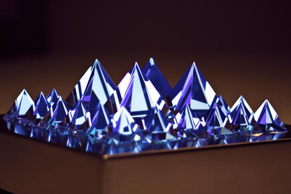 Pyramidal Prisms Over a Flat Panel Display
