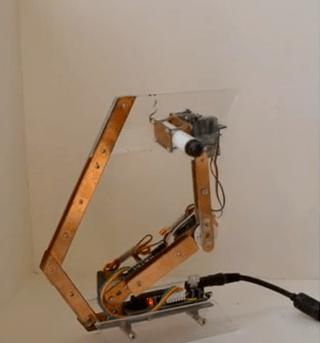 Artbot Clock Draws the Time