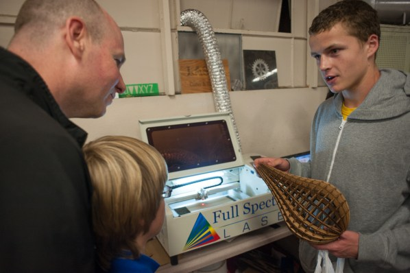 A student explains how the laser cutter works.