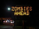 Altering digital signs is good for laughs as well as inspiring a healthy fear of the undead.