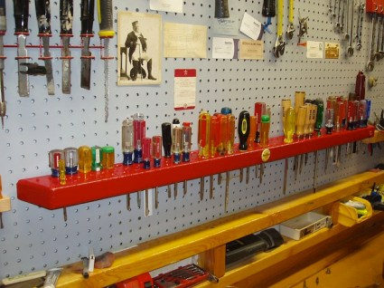 If you're planning to go vertical in your workshop, pegboard can be your best friend. It's inexpensive, and there are so many add-ons you can buy that provide near-infinite organizational possibilities.