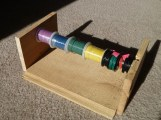 If you have lots of wire spools they can get hopelessly tangled with each other. Solve this with a simple holder. You can buy one or build one. I put mine together in less than an hour with some scrap wood and a wooden dowel.
