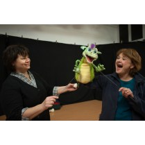 Portuges and Armstrong demonstrate their smoke-breathing dragon puppet.