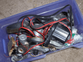 There are many among us who are parts scavengers, but make sure to do it smartly! Strip the parts off that you need, organize them, and junk the rest. This is my bin of motors, gears, belts, and pulleys.