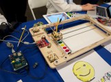 The CNC bot (controlled with EggBot electronics) will recreate a drawing of your own from an iPad. See it at Maker Faire in May!