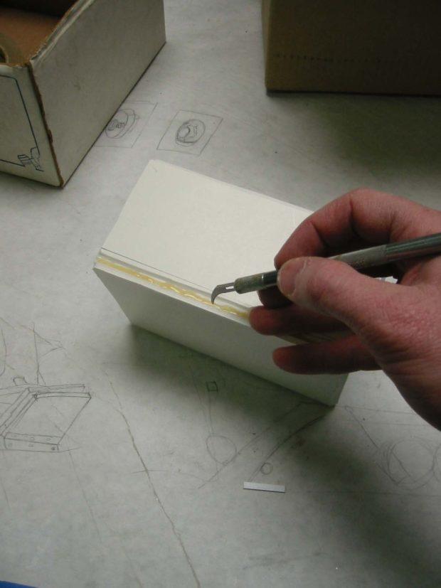 Fig. K: Cutting the box seam.