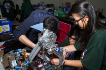 Students in Fiesta hall working on a competitive robot.