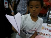 A paper airplane with a glowing red nose.