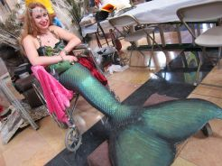 Laguna Mermaid hand-sculpted her costume out of silicone—and she's available for hire to tell stories, and yes, swim at your pool party. http://on.fb.me/17zNLxe