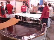 Placing tape on the vacuum bag and cutting cell core before applying carbon fiber.