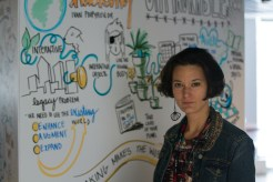 """Heather in front of a graphic she drew for Ivan Poupyrev's talk on """"Hacking the Unhackable"""" on Saturday."""